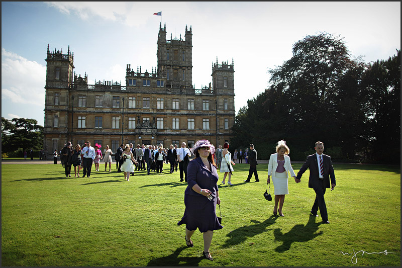 Wedding guests walking away from Highclere Castle