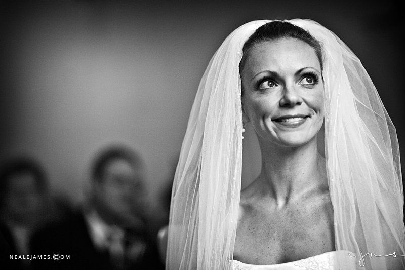 Black & white portrait of a bride during her wedding ceremony at Notley Abbey