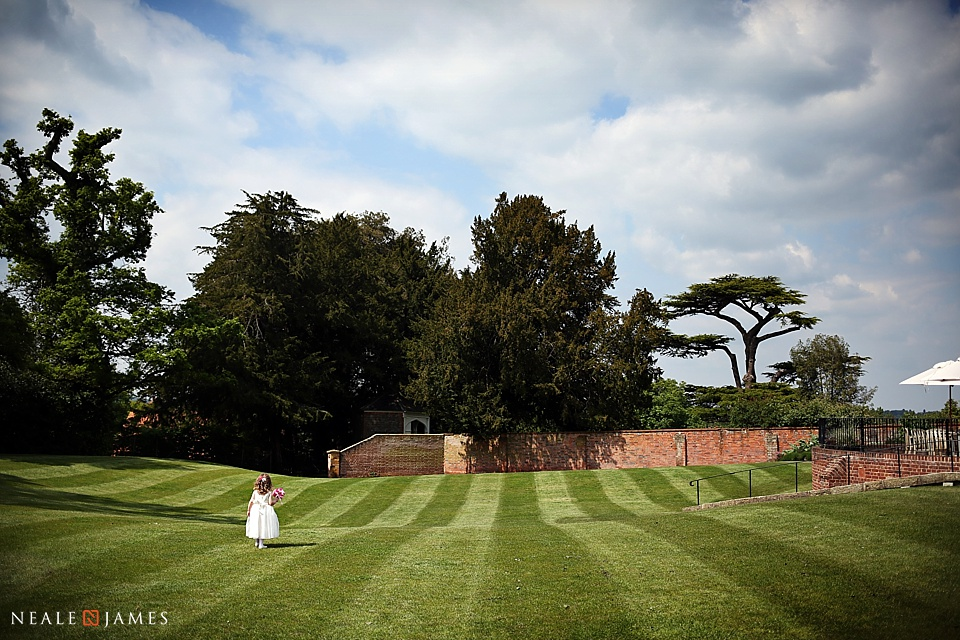 A young bridesmaid on the lawn