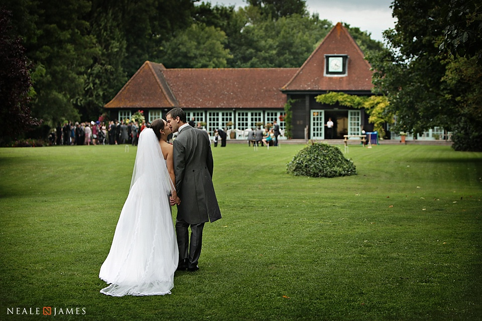 Photograph of a couple on their wedding day at Queen's Eyot