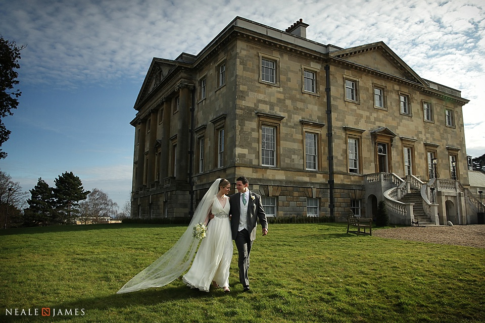 Bride and groom in front of Botleys Mansion