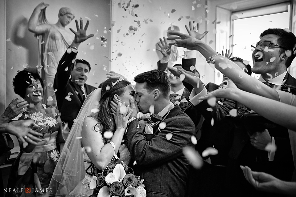 Picture of confetti being thrown over a bride and groom at a wedding