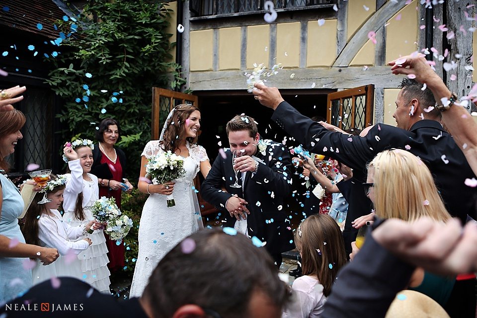 Picture of confetti being thrown at Cain Manor wedding venue