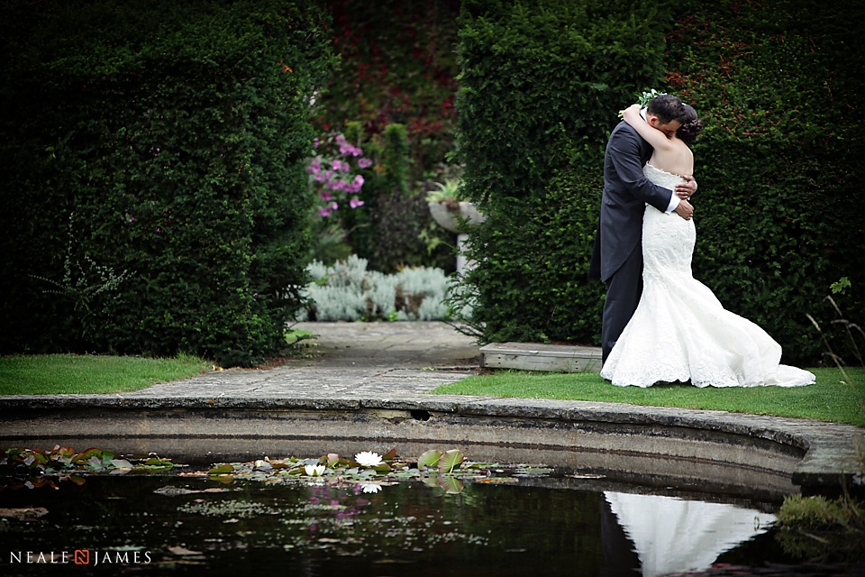 Colour picture of bride and groom in the gardens at Horwood House in Bucks