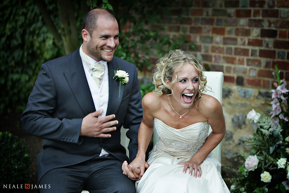 Outdoor ceremony at Notley Abbey, colour photograph of bride and groom