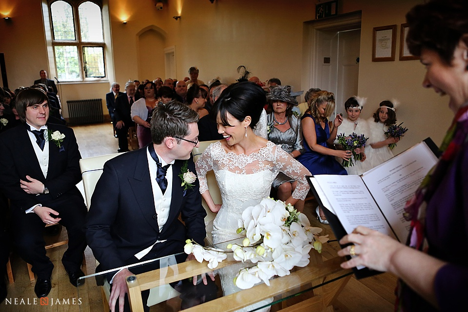 Notley Abbey colour photograph of a civil ceremony featuring a bride and groom