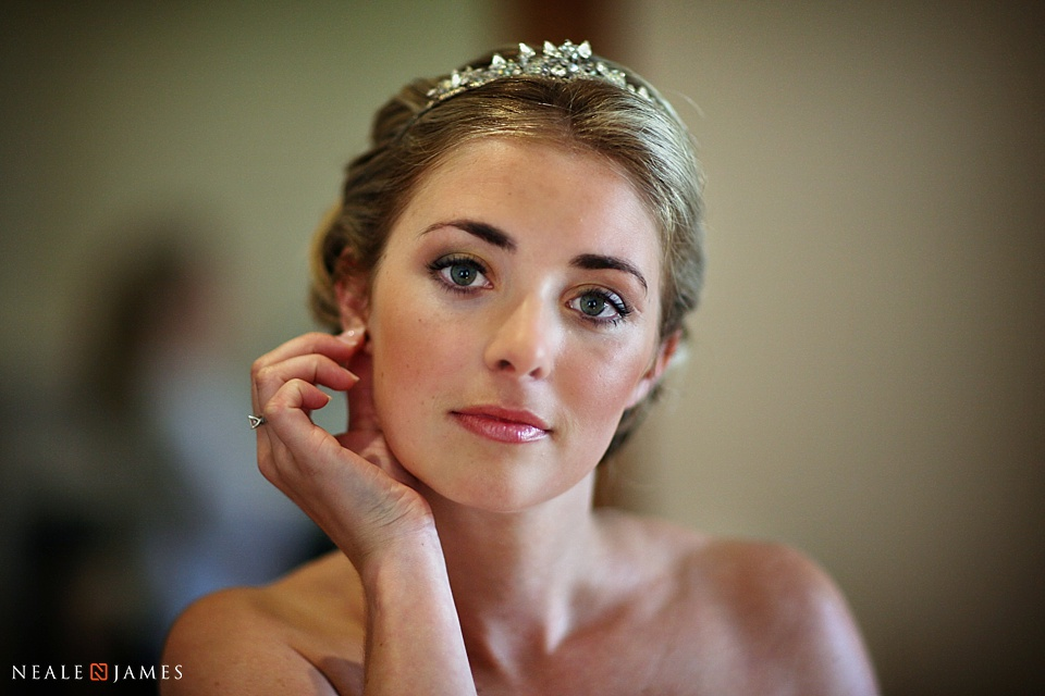 Colour photograph of a bride posing for a picture at Notley Abbey