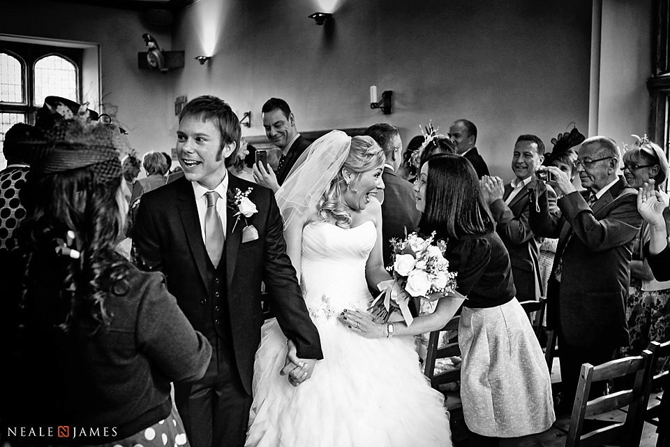 Black and white of wedding recessional