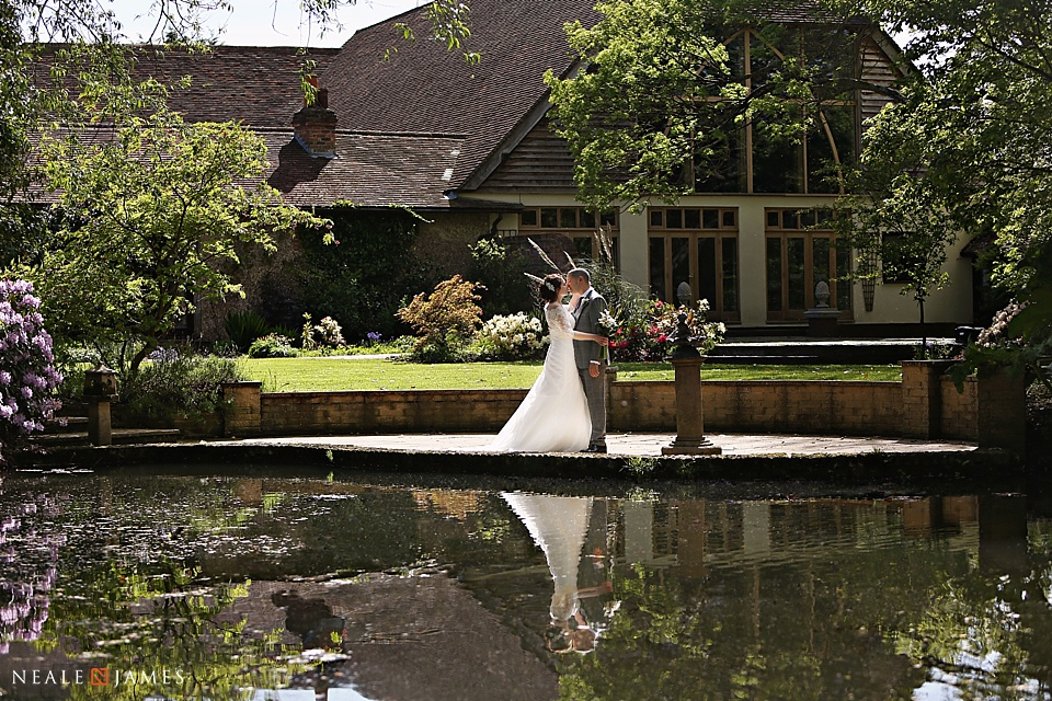 Picture taken in the gardens at Rivervale Barn of a bride and groom