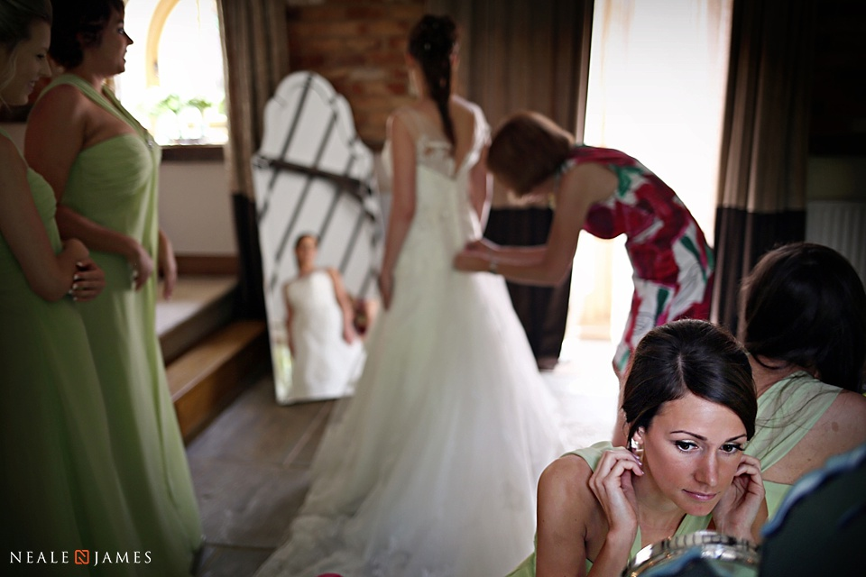 Photograph in colour of bridesmaid preparing herself prior to a wedding