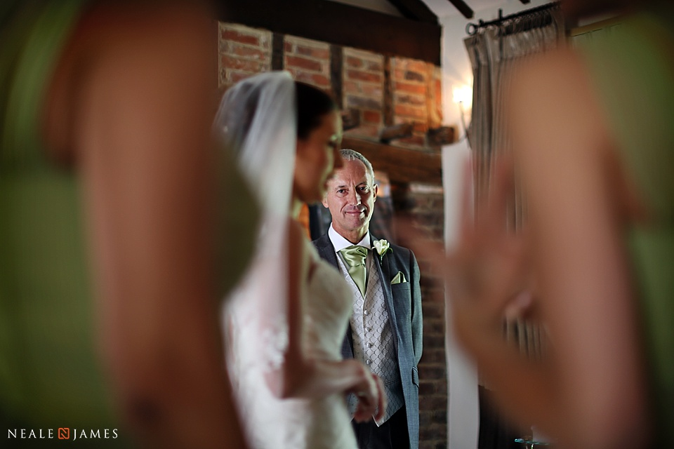 Proud father of a bride looking at his daughter prior to a wedding