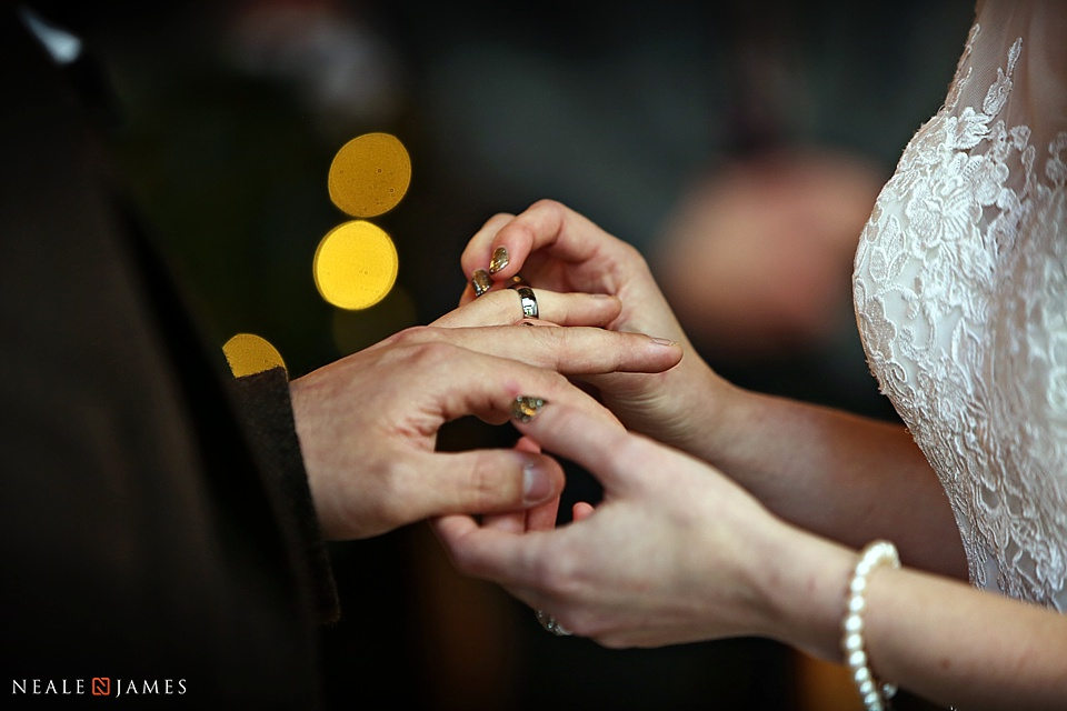 Colour picture of wedding rings being exchanged