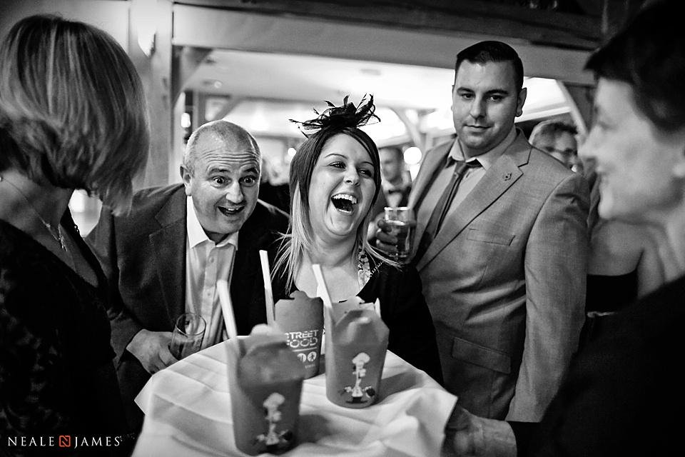 Black and white picture of wedding guests laughing