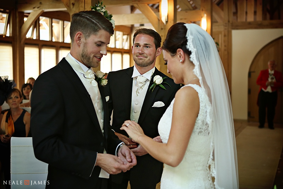 Bride and groom exchanging rings at a wedding