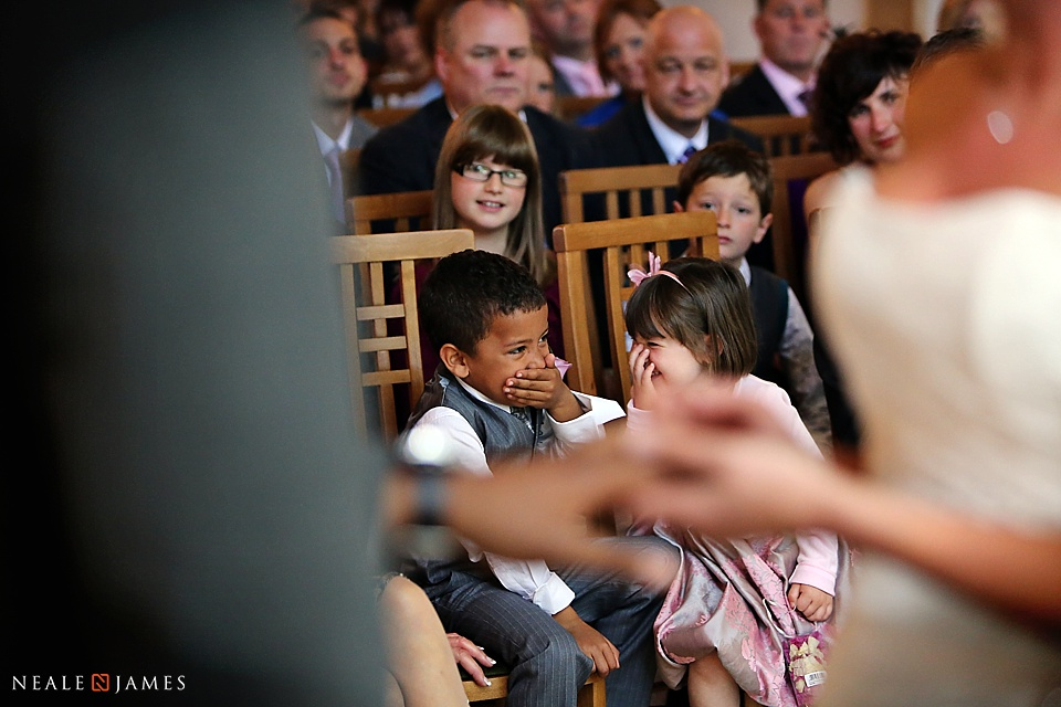 Picture of children laughing during a wedding ceremony