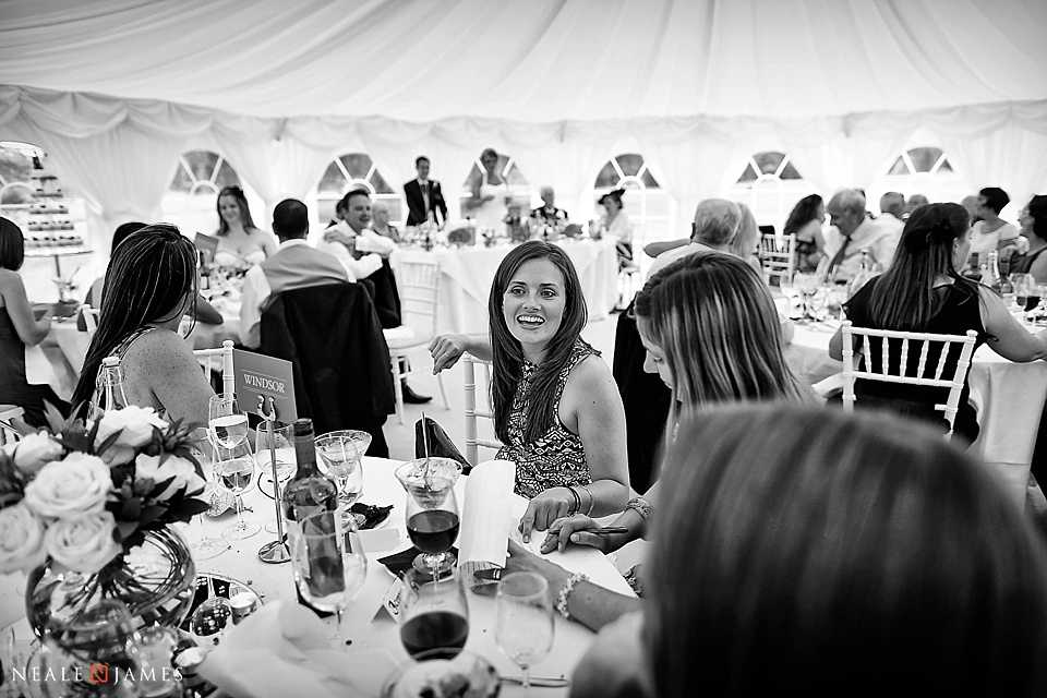 Black and white photograph inside a wedding marquee
