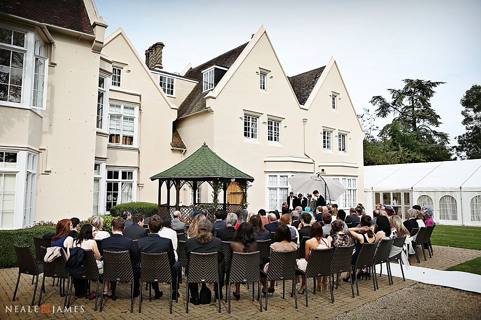 An outdoor wedding ceremony photographed in colour in Berkshire