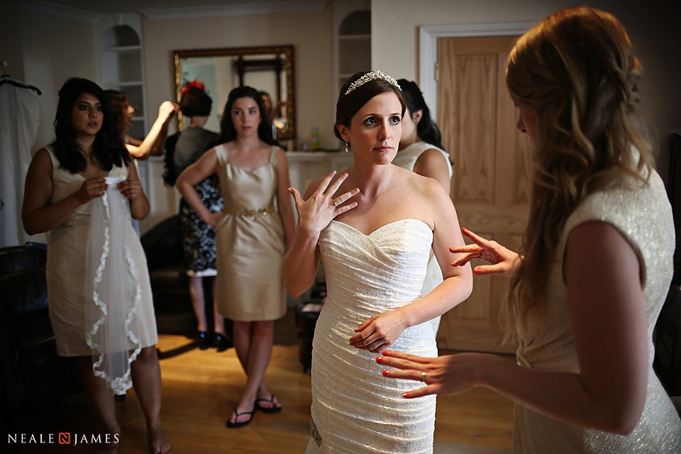 Colour photograph of bride getting ready for wedding