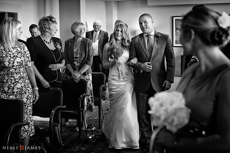 Black and white picture of a wedding ceremony at The Aviator Hotel in Farnborough