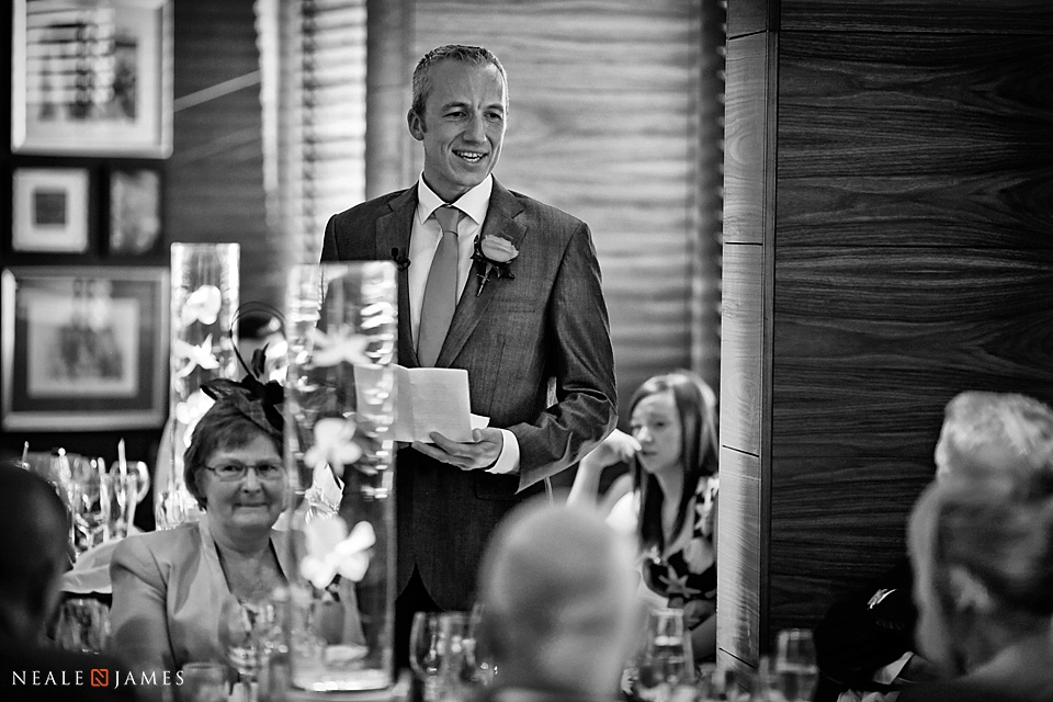 Best man making a speech in a black and white photograph