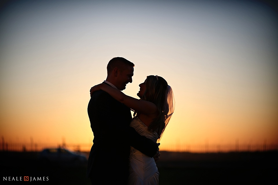 Colour picture of a bride and groom at sunset
