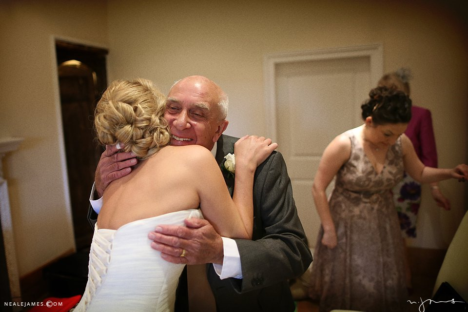 Father greets bride at wedding