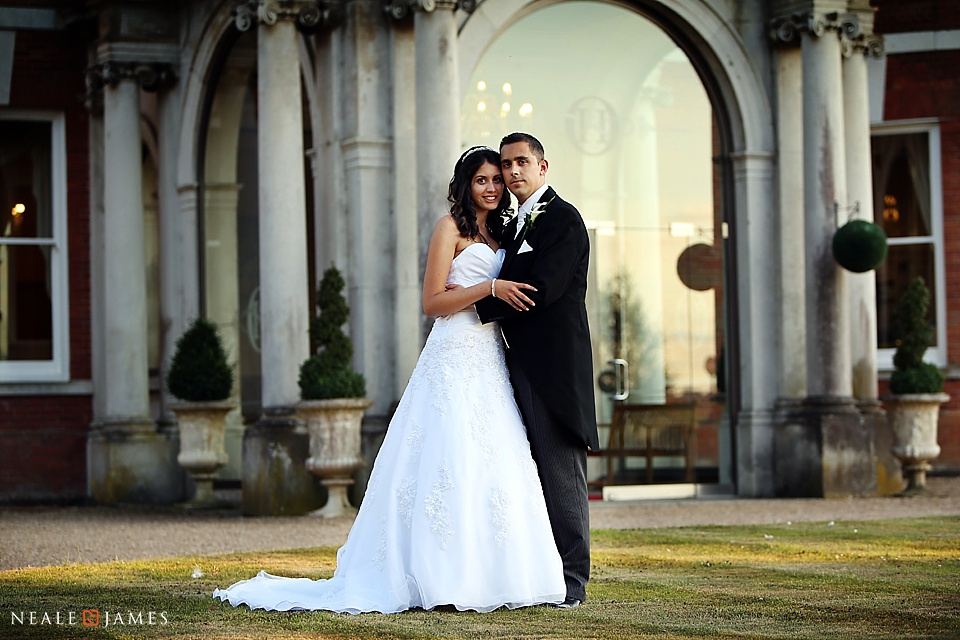 Colour pictures of bride and groom with Oakley Hall behind them