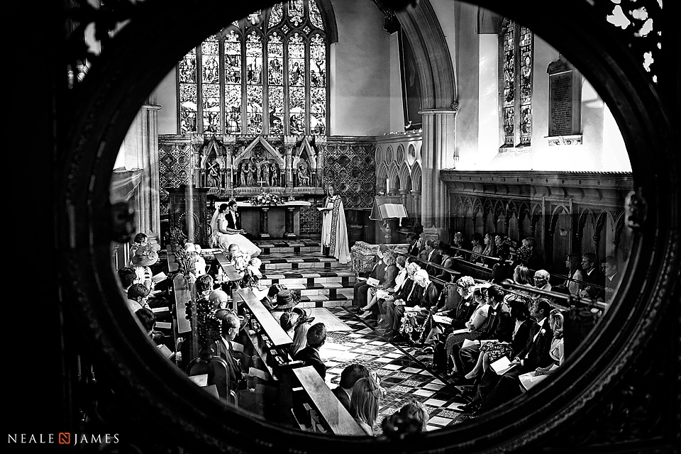 Black and white photo of marriage at Jesus College Chapel