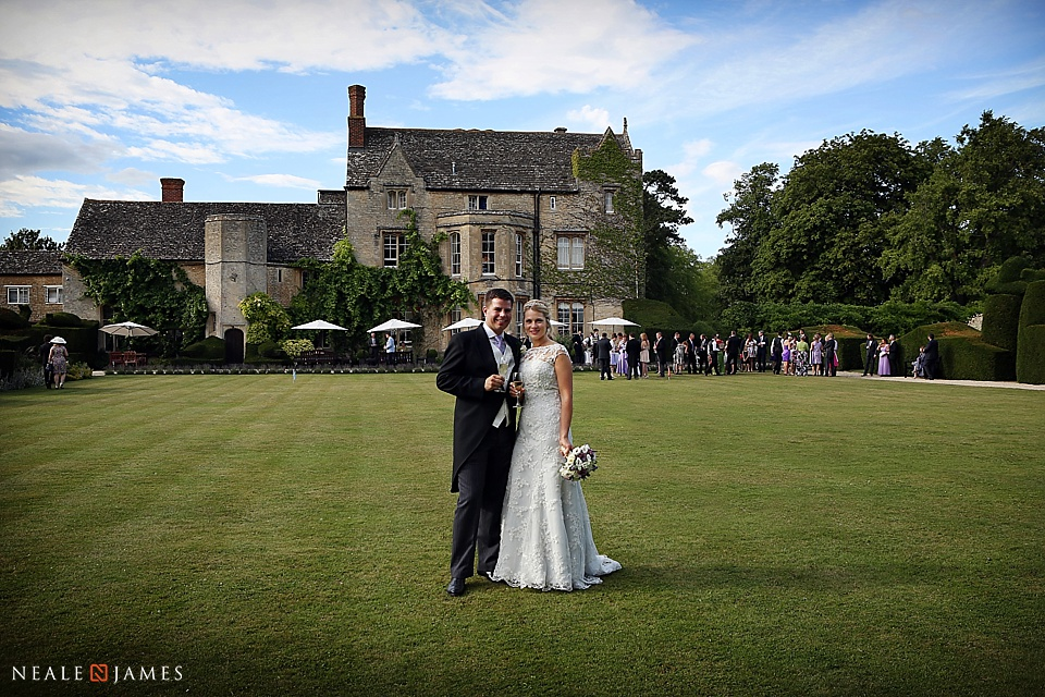 Colour photograph of bride and groom at Manor at Weston-on-the-Green