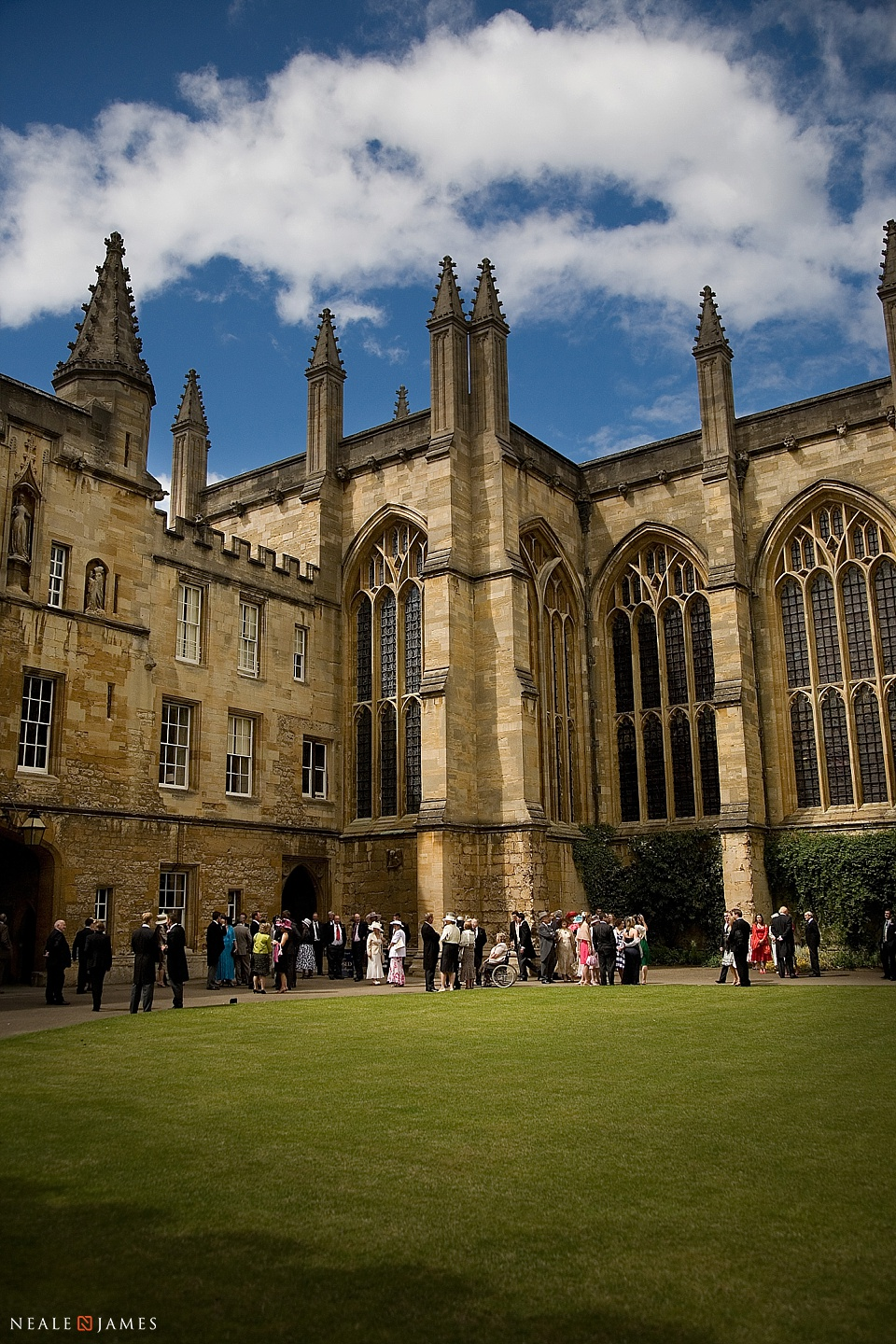 Colour photograph of wedding party in front of the chapel at New College Oxfrod
