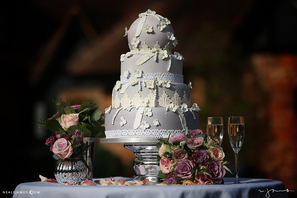 Ornate wedding cake and pastel flowers from a wedding at Sanctum on the Green