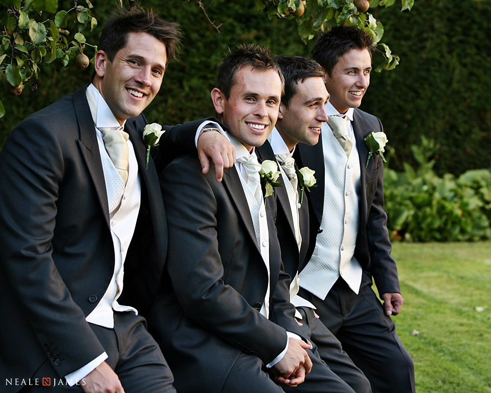 Colour picture of groomsmen posing together at Notley Abbey near Thame