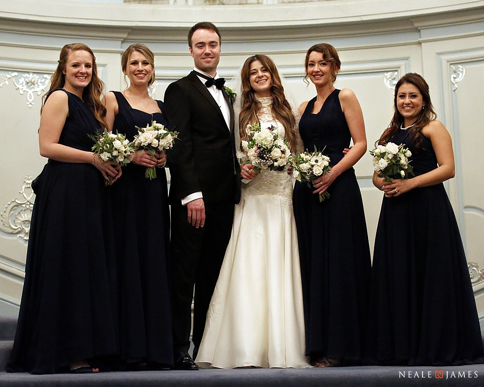 Colour photograph of the bridal party having a group formal shot together