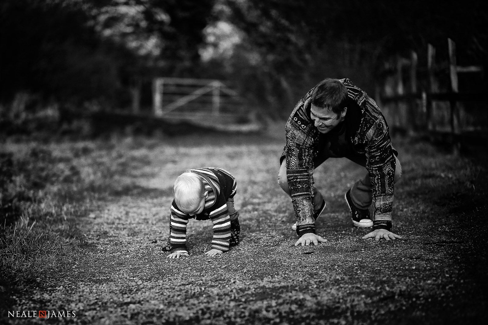 A father playing leapfrog with his young son
