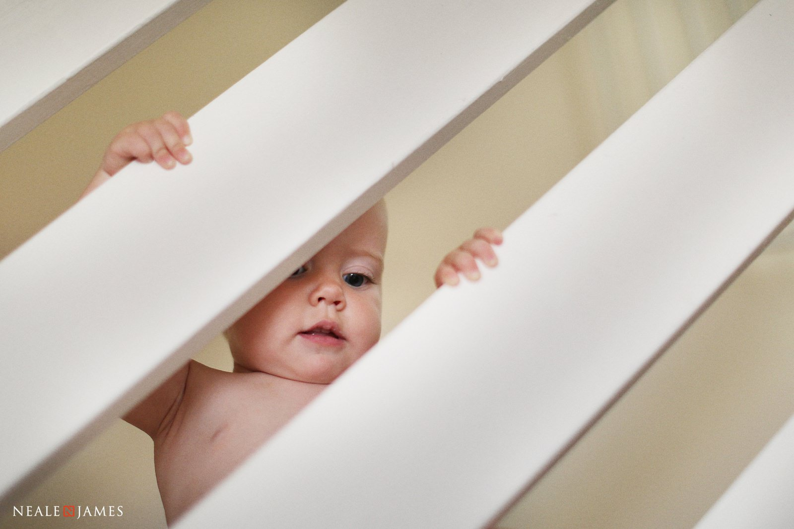 A baby climbing the stairs