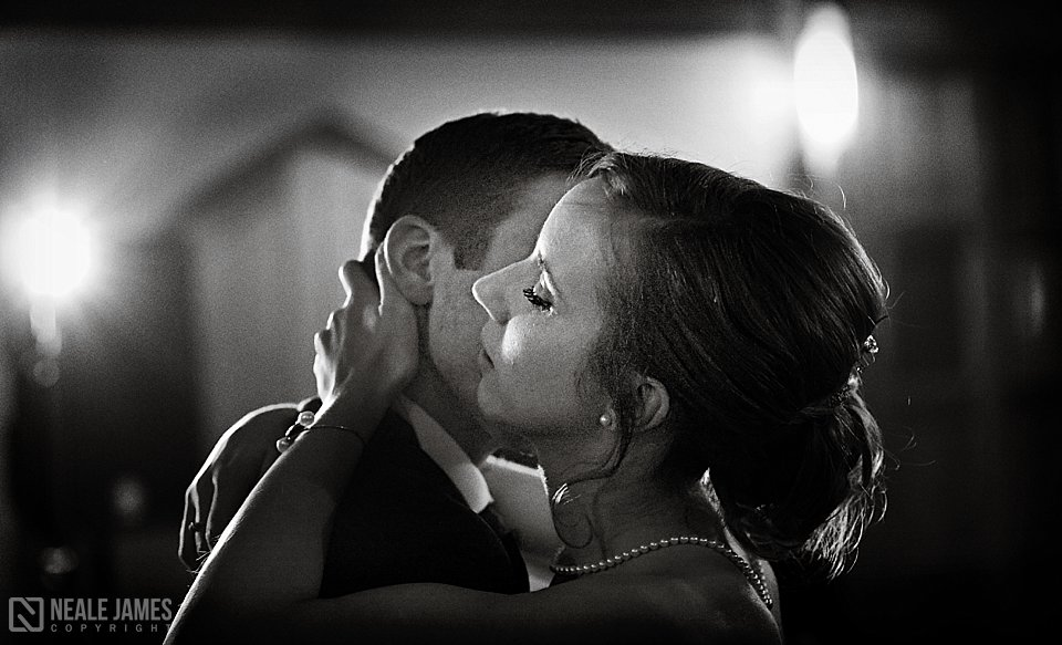 A couple gently embrace during their first dance
