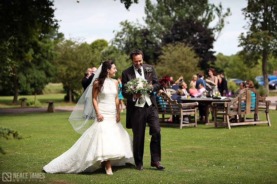 A bride and groom take a stroll round the beautiful grounds of Maunsel House
