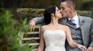 Bride and groom kiss at Gate Street Barn
