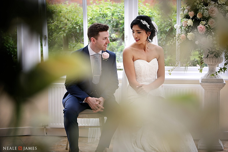 A bride and groom during their civil ceremony at Combermere Abbey