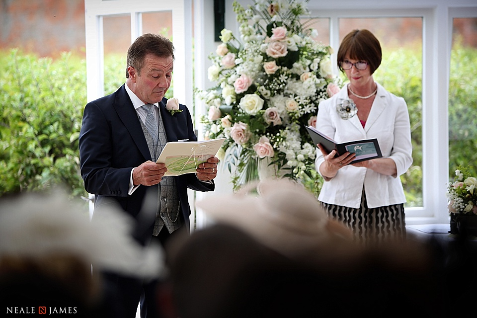 A guest doing a wedding reading at Combermere Abbey
