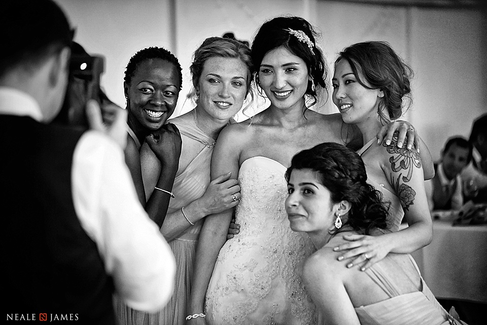 A bride poses with her friends at Combermere Abbey