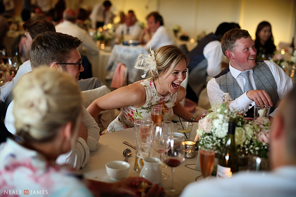 Guests laughing during a Combermere Abbey wedding