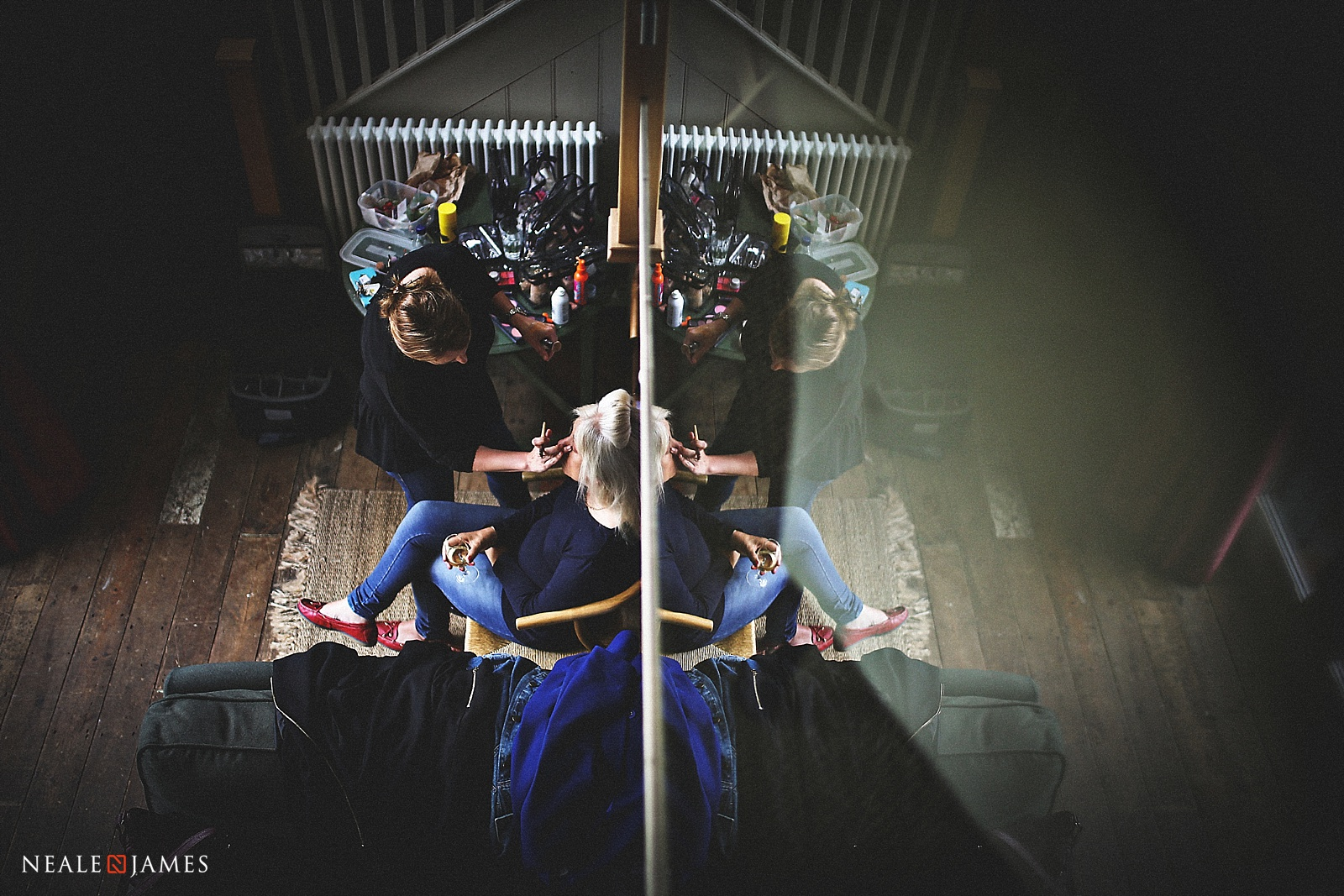 A reflection of a bride having makeup applied