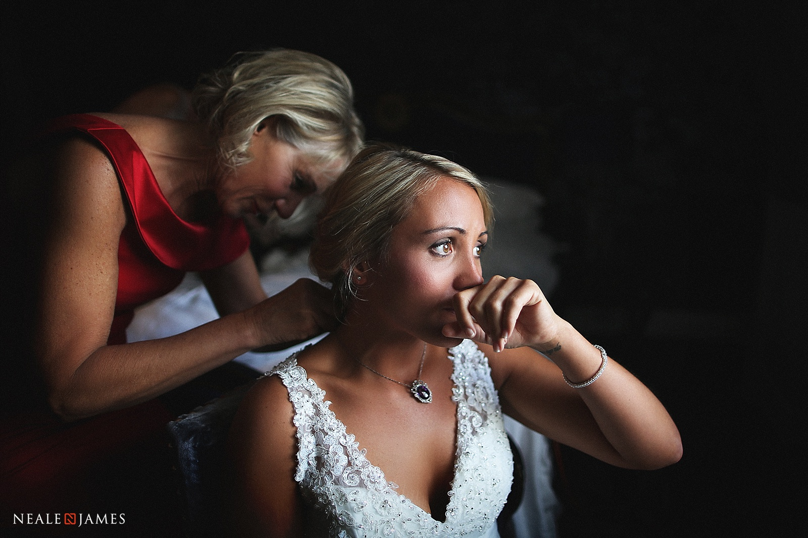 Colour picture of a bride receiving a gift from her mother