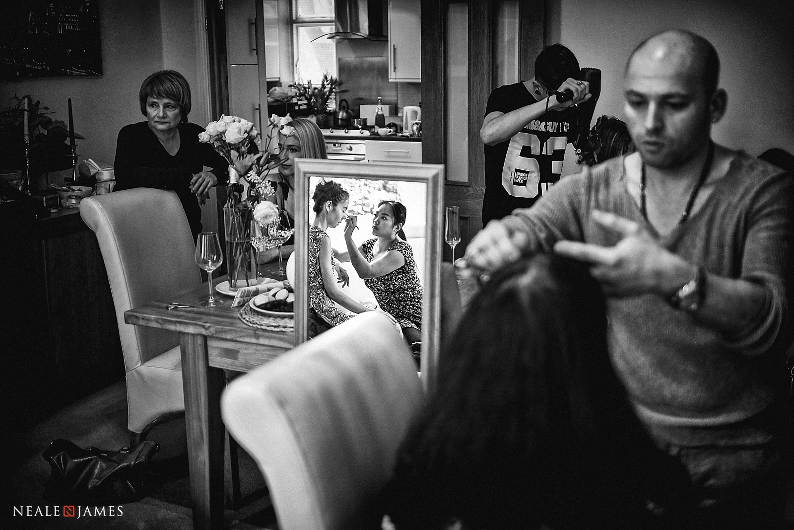 Black and white picture of bridesmaids being made up