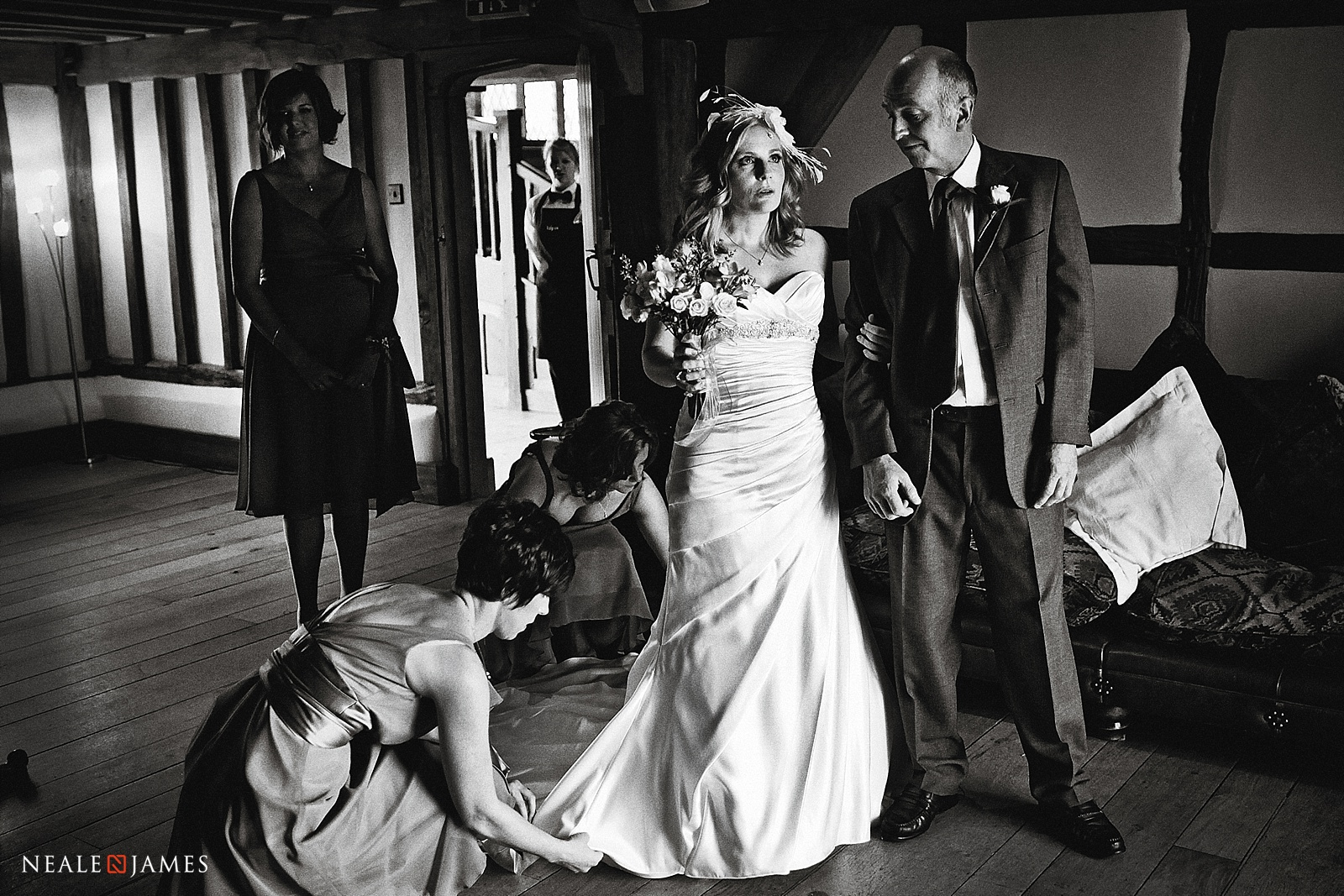 Black and white picture of a bride anticipating the start of her wedding