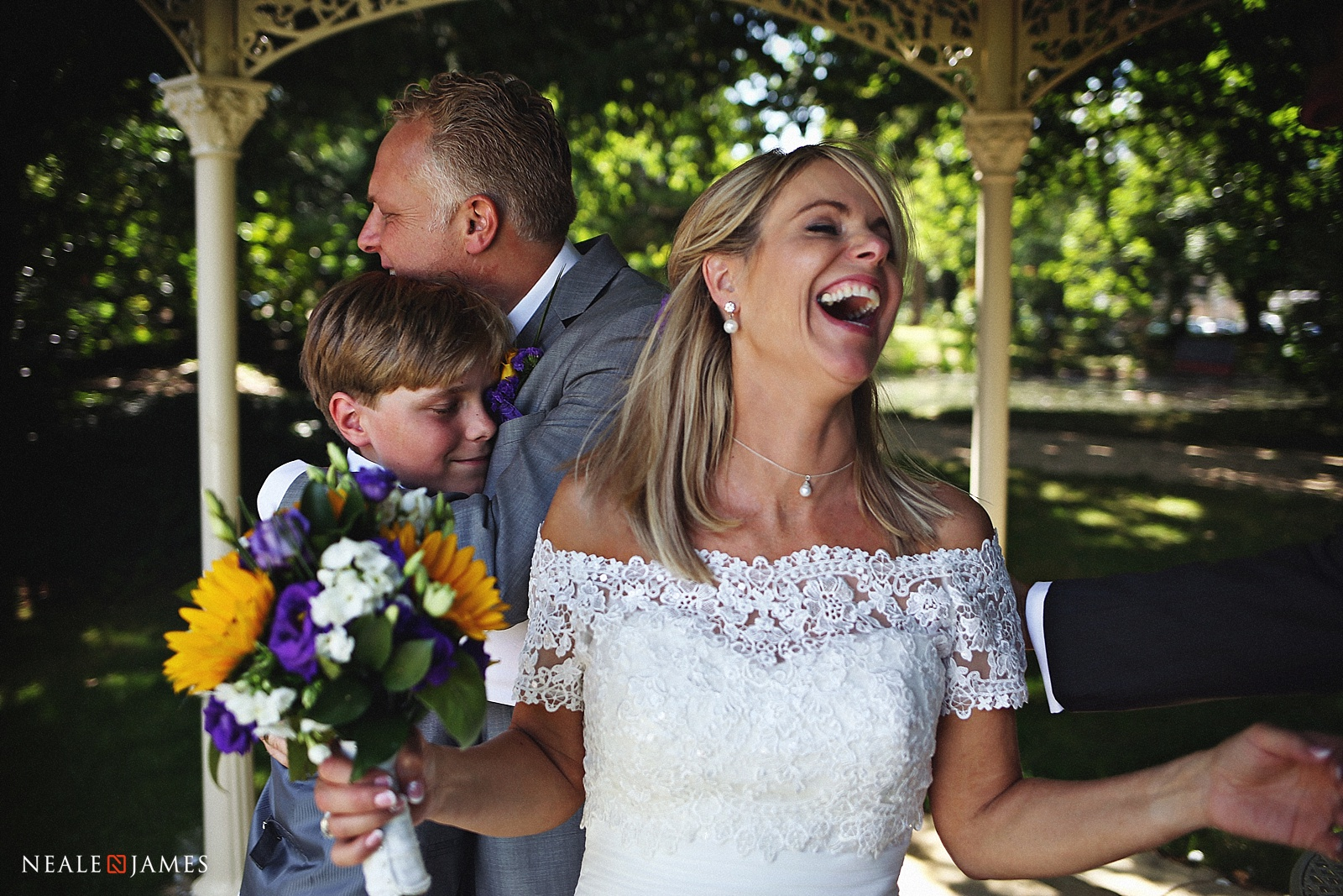 A mother laughing with joy at a wedding