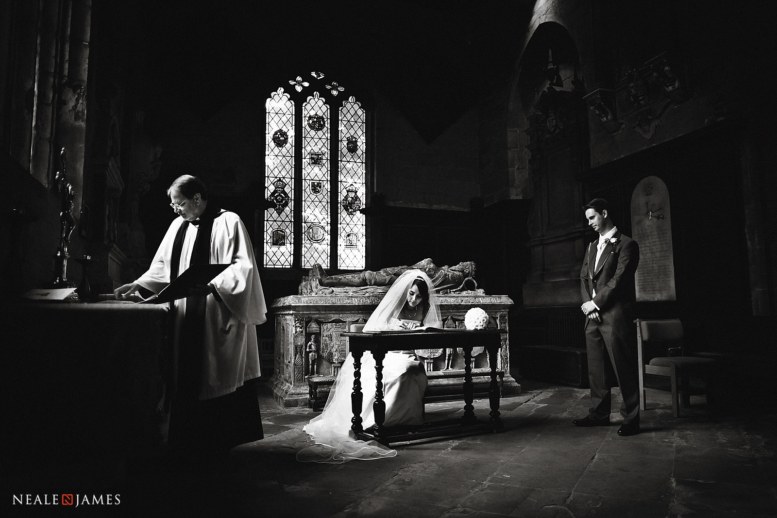 A monochrome picture of a register being signed in church