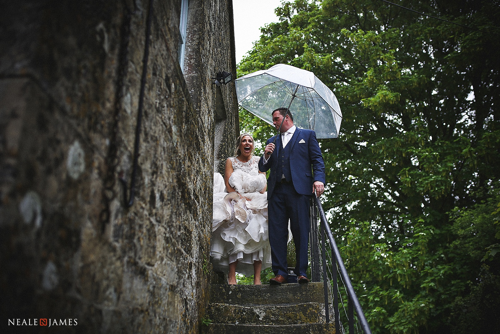 Bride and groom leaving church in the rain