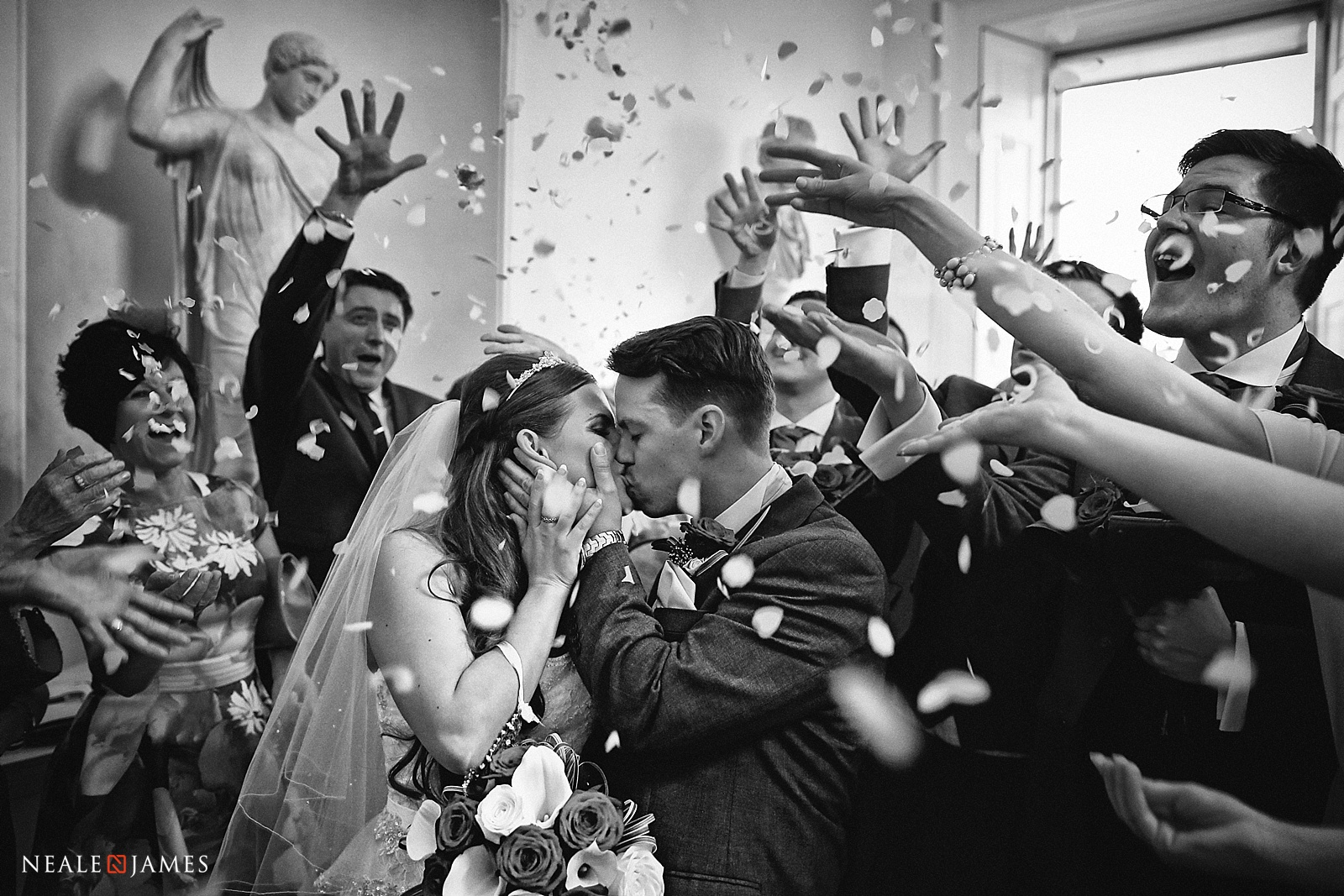 Black and white picture of confetti being thrown at Botleys Mansion